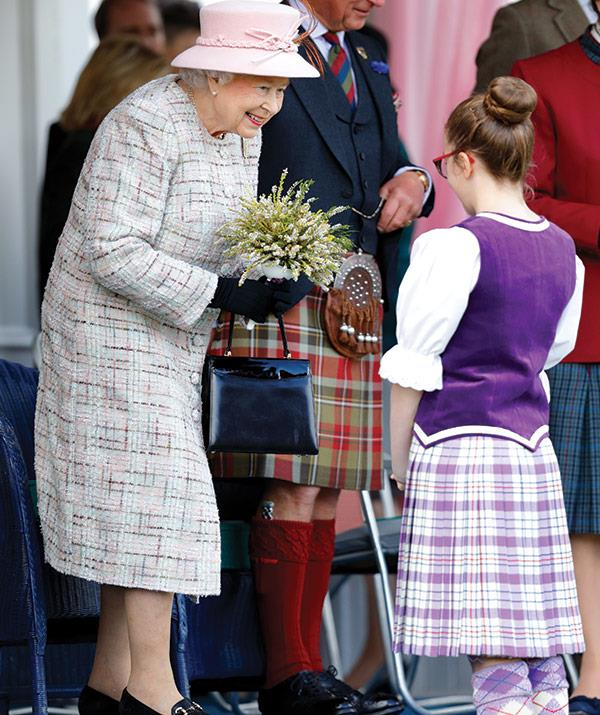 The Queen chats to one of the dancers.