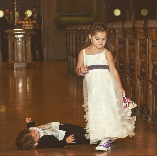 This flower girl sure showed him who's boss!