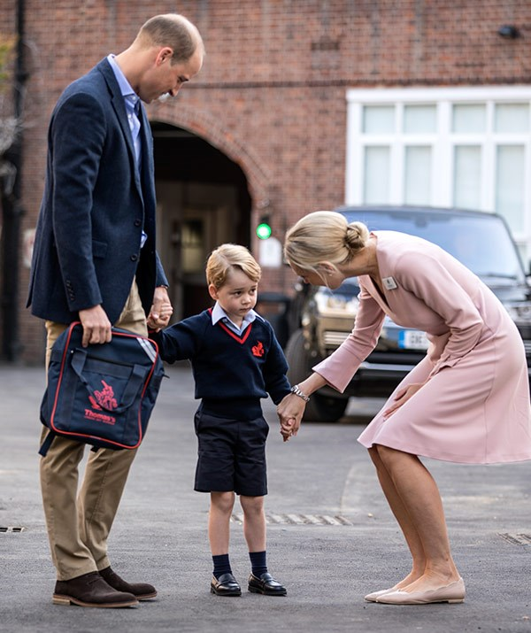 "**Prince George, 2017** <br><br> Young George looked a wee bit apprehensive as he met his teacher on his first day of school at Thomas's Battersea, [but we have it on good authority (Prince William's)](https://www.nowtolove.co.nz/celebrity/royals/prince-william-reveals-georges-first-day-of-school-went-well-34178|target=""_blank"") that his first day went off without a hitch! This week starting Year 2, we're sure he'll be eager to show younger sister Charlotte the ropes, now that she'll be joining him.  <br><br> *(Image: Getty)*"