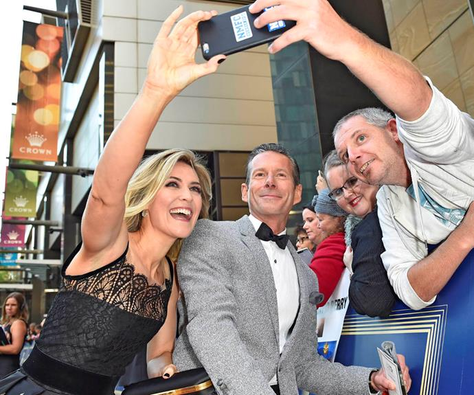Jenni Baird was all smiles at this year's TV WEEK Logies, posing for a pic with APTCH co-star Brett Climo and some fans.