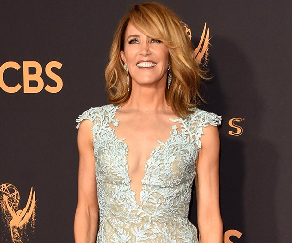 **Felicity Huffman** is also giving us hair trend throw-back, with her deep-side part and side-swept fringe. Take note, we'll be seeing more of the side-part this season.