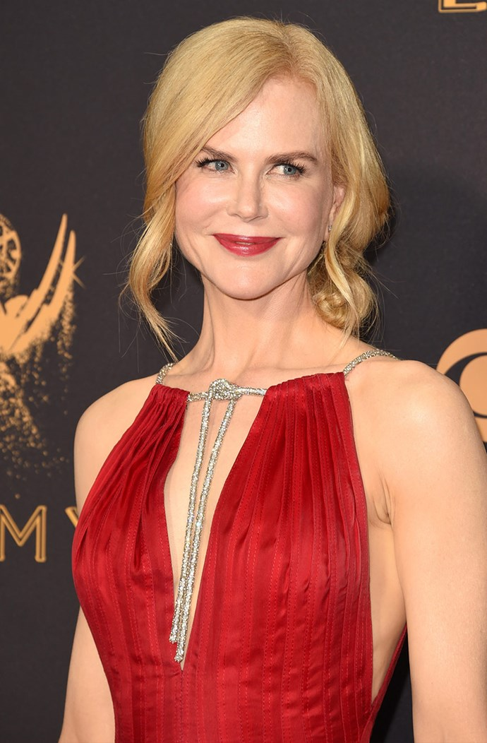 How does she do it? **Nicole Kidman**'s skin looked flawless as always. She teamed a strawberry lip with her red, Calvin Klein gown.