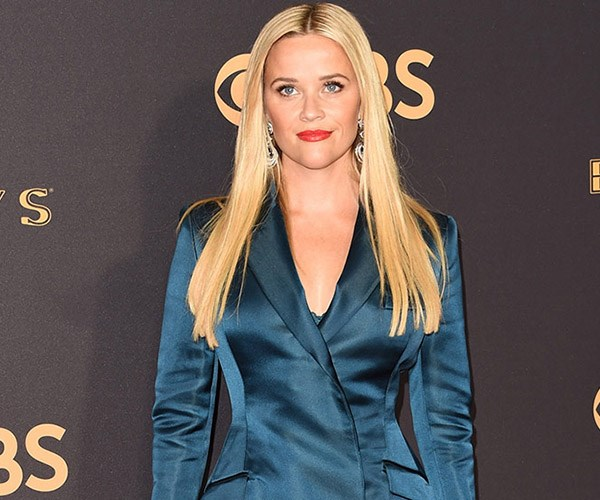 **Reese Witherspoon** made a case for a middle-part and pin-straight locks when she arrived on the red carpet.