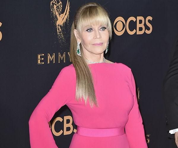 **Jane Fonda** is pretty in pink at the 2017 Emmys, but we can't get over *that* pony! Jane, 79, debuted a fresh new look with the help of a glossy, faux pony tail and full fringe. Nailed it!