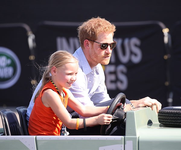 He's the king of the kids! The 33-year-old joked around with a little girl at the Jaguar Land Rover Driving Challenge ahead of the Games.