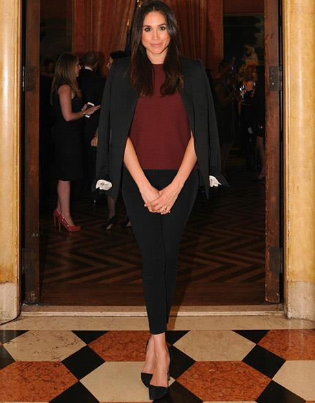 "Meghan knows that a deep ox-blood red is one of ""her colours"". Here she demonstrates just how to look chic, polished and ready for anything in a simple top, pants and blazer ensemble. Perfect!"