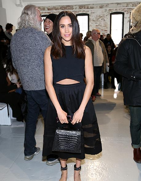 Meghan knows how to rock every girl's go-to ensemble: the all-black outfit. She looks super cute in a cropped top and full-skirt, while supporting fashion designer **Misha Nonoo**'s at a 2015 fashion show.