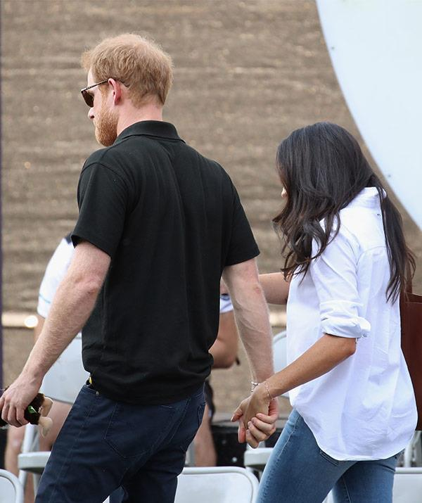 Meghan and Harry didn't leave each other's side.