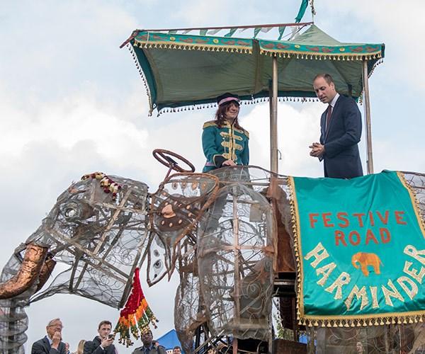The Duke of Cambridge stands on a mechanical elephant...