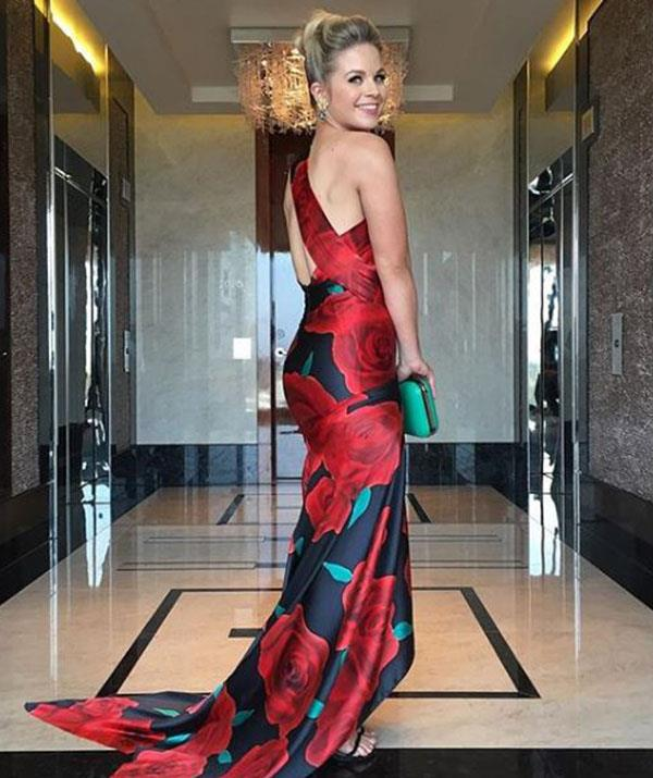 Emma Freedman, wearing Pallas Couture, is hosting the awards tonight.