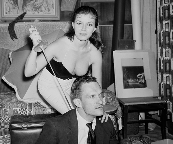 A young Hugh jokes about with Joan Bradshaw at one of his famous Playboy parties in 1957.