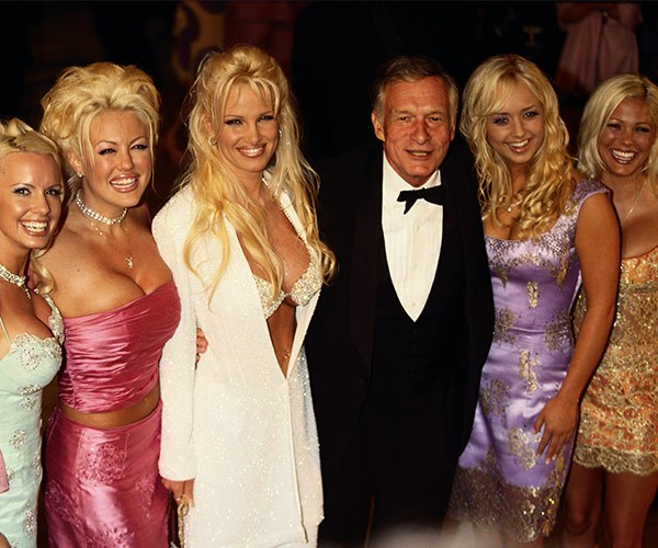 The mogul was never without a bevy of blondes by his side...