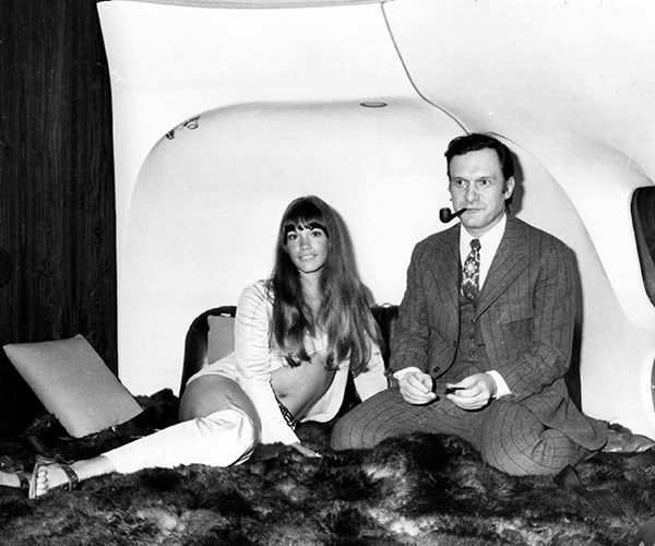 "Travelling in style! Hef and his girlfriend at the time, **Barbi Benton**, on board his his luxury DC-9 aircraft ""The Big Bunny"" at Heathrow in 1970."