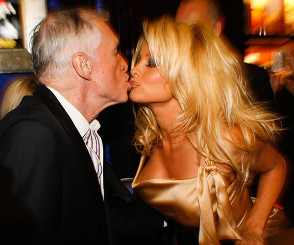 Pamela Anderson plants a wet one on the man who helped launch her career.