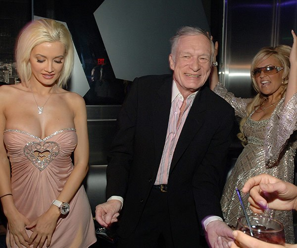 Hef and his girlfriends Holly and Bridget cut some mad shapes on the dance floor during his 81st birthday bash in Las Vegas.