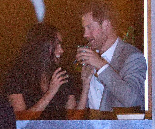 The royal enjoys a well-deserved drink.
