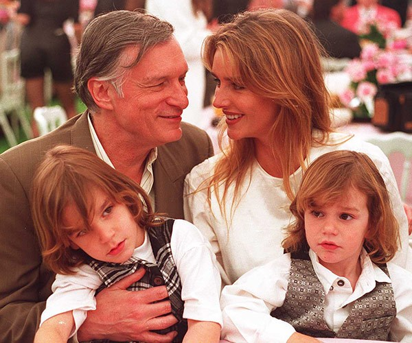 Hugh, pictured with his two sons Marston, Cooper and ex-wife Kimberly in 1994, was laid to rest in his iconic silk pyjamas.