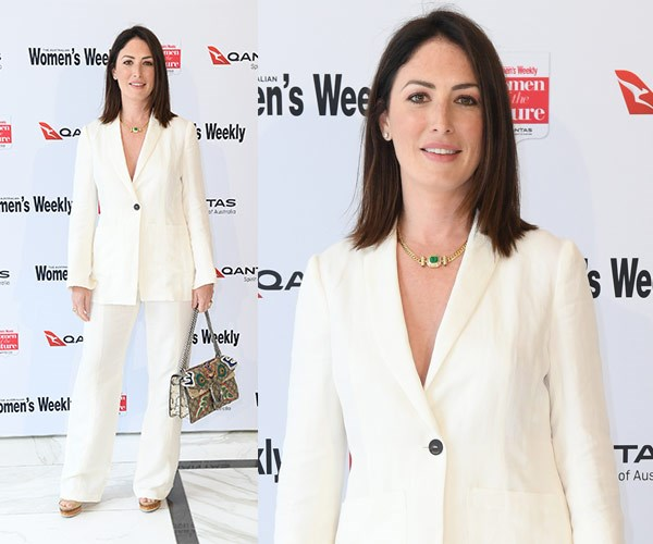 Sara McGrath keeps it classic in a tailored white suit.