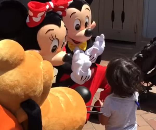 "The little boy's dreams came true when his Disney heroes used sign language to say ""I love you""."