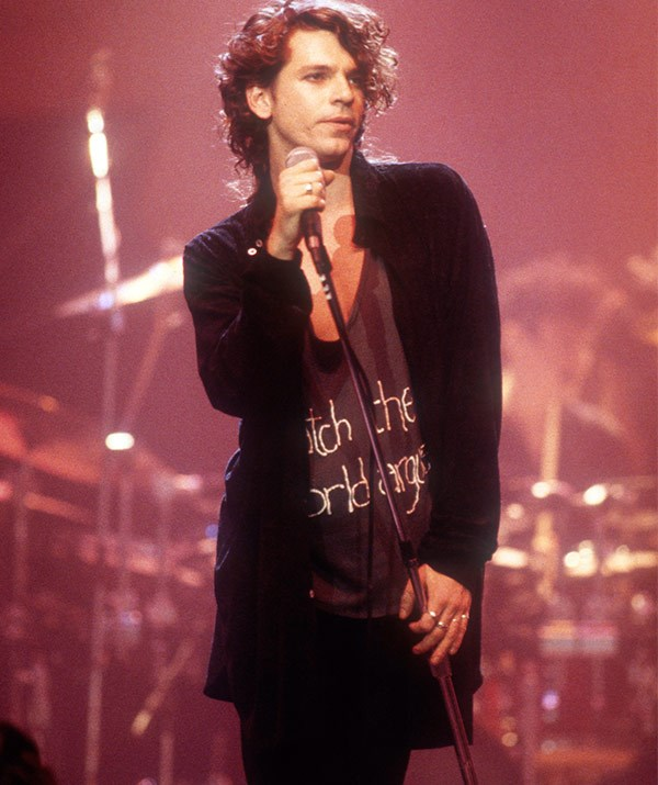 """Leader singer [**Michael Hutchence**](https://www.nowtolove.com.au/celebrity/celeb-news/tiger-lily-hutchence-celebrates-sir-bob-geldofs-wedding-28049 target=""""_blank"""") became the main spokesperson for the band, and gained a reputation as a confident, sexy frontman, although his close friends and family always maintained he was much more introverted than his on-stage persona."""