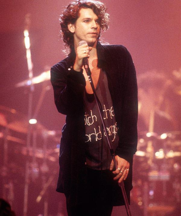 "Leader singer [**Michael Hutchence**](https://www.nowtolove.com.au/celebrity/celeb-news/tiger-lily-hutchence-celebrates-sir-bob-geldofs-wedding-28049|target=""_blank"") became the main spokesperson for the band, and gained a reputation as a confident, sexy frontman, although his close friends and family always maintained he was much more introverted than his on-stage persona."