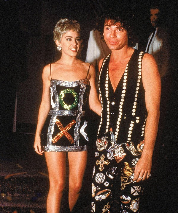 """In 1989 Michael started a relationship with Aussie pop princess [Kylie Minogue](https://www.nowtolove.com.au/tags/kylie-minogue target=""""_blank"""") — then a fresh faced 21-year-old singer who'd only recently left the set of *Neighbours* to launch her music career. Michael joked at the time that his favourite hobby was """"corrupting Kylie"""" and he wrote the **INXS** song *Suicide Blonde* in reference to her."""