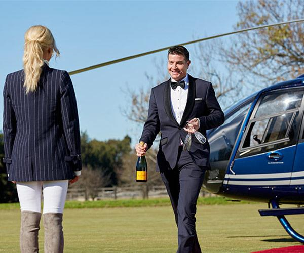Stu Laundy made one hell of an entrance when he stepped out of this helicopter with a bottle of champers in hand.