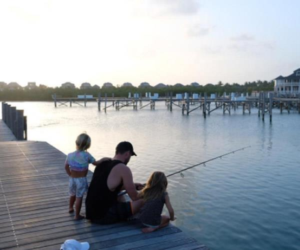 "Gone fishin'! Aussie hunk Chris Hemsworth has been enjoying a well-deserved break with is family in between films. The *Thor* star took to Instagram to share a sweet sunset snap of himself and two of his tiny tots fishing off a pier. ""Epic weekend with these little legends,"" he captioned the family 'gram."