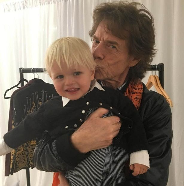 **Mick Jagger**: Snapped here with his adorable grandson, Ray, The Rolling Stones' rocker is a father to eight children, a grandfather to five *and* a great-grandfather to another.