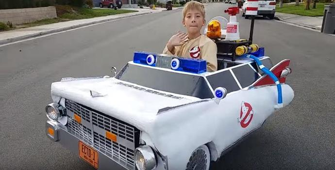 Jeremy all revved up to to go trick-or-treating in his *Ghostbusters* wheels.