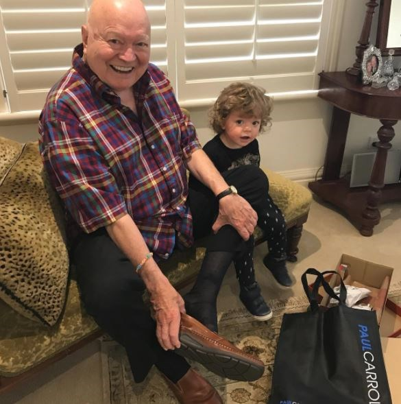 **Bert Newton**: The celebrated entertainer adores spending time with his four grandchildren, including trying on shoes with the super-sweet little Monty!