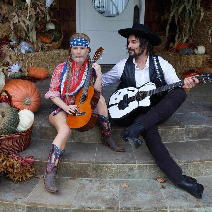 Jessica Simpson, is that you?! Jess, dressed as Willie Nelson, with her husband, Erin Johnson (who's guise resembles Willie's long-time music collaborator, Waylon Jennings), are taking country tunes to the next level!