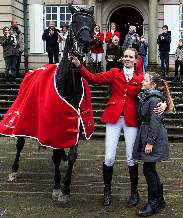 Princess Isabella poses with one of the race's competitors.