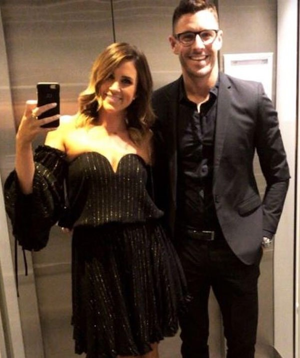 Georgia Love shared a standard lift selfie ahead of the big day. She may have skipped on the head-piece but she has her favourite accessory in tow... Lee Elliott.