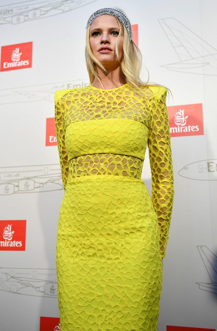 Lara Stone is the Emirates guest of honour and is glowing in lemon.