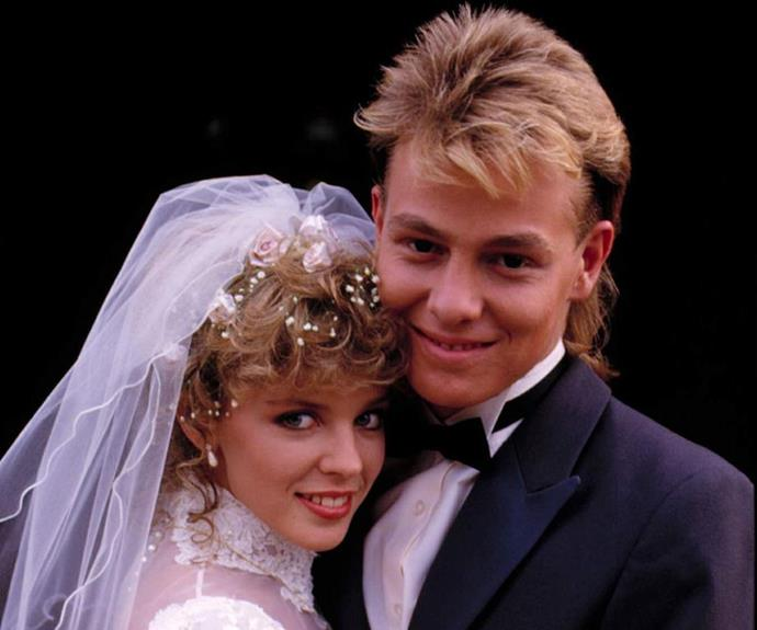 **Scott and Charlene Robinson -** ***Neighbours***  <br><br> Scott (Jason Donovan) was the golden boy of Ramsay Street who came across Charlene (Kylie Minogue) after she arrived in the neighbourhood from Queensland. At first the two hated each other, but soon the young couple couldn't get enough of each other. Their wedding was the penultimate episode of Neighbours for years to come.