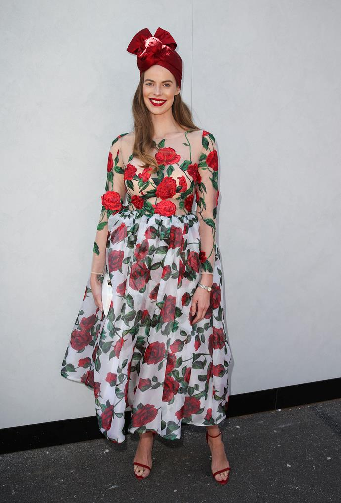 Robyn Lawley is ringing in Christmas early this year, opting for an appropriately frock-and-fasincator get-up. If we had to call it, we'd say this rose is our pick of the trackside bunch!