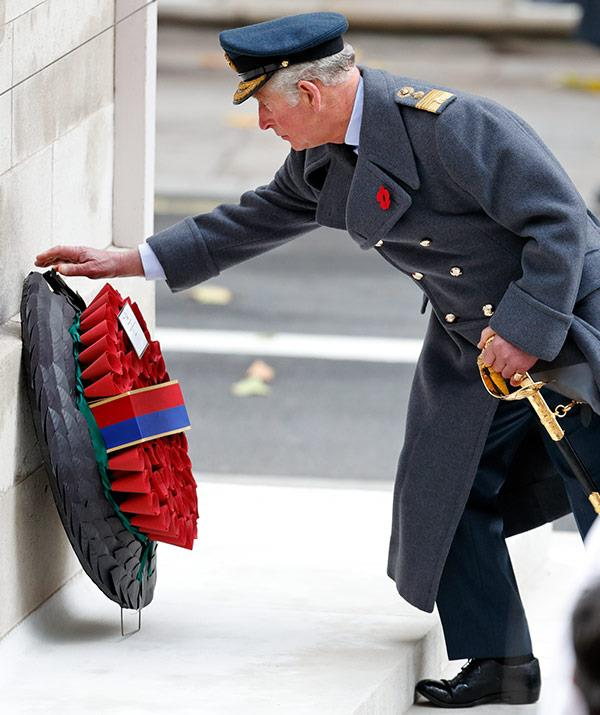 Prince Charles lays a wreath on behalf of his mother.