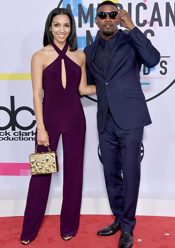 The 21-year-old looked flawless in a purple jumpsuit, while her dad was dapper for days in a fitted navy suit.