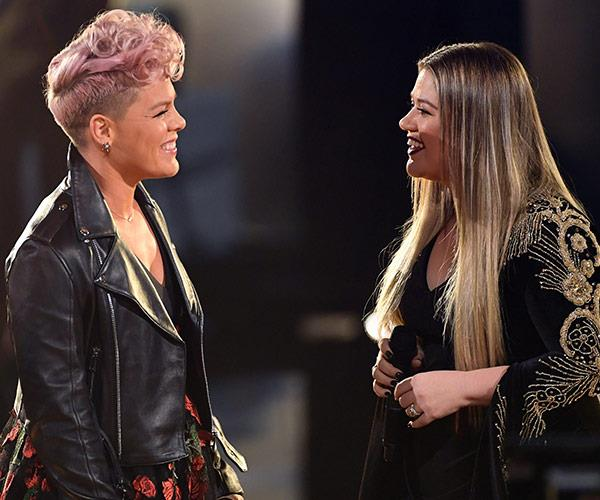 And the show is live! Country goes rock with Pink and Kelly Clarkson performing a stunning duet of R.E.M.'s *Everybody Hurts*.