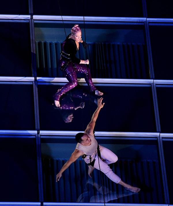 Just scaling a building... All part of Pink's charm!