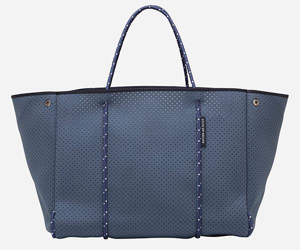 """Sometimes you want something a little more luxurious than a nappy bag slung over your shoulder. This State Of Escape neoprene bag was heralded by mum-of-two, [Zoe Foster-Blake](https://www.nowtolove.com.au/fashion/fashion-trends/zoe-foster-blakes-best-maternity-moments-35391 target=""""_blank""""), for its ability to carry all essential baby items. Plus, it can go in the wash! [$299, State Of Escape](https://www.stateofescape.com/collections/all/products/new-escape-bag-in-pewter-white-dual-tone target=""""_blank"""")."""
