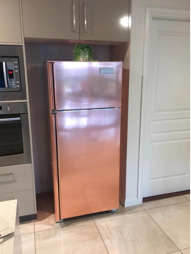 "This could be the best hack of the year. Gypsy is a Kmart Mum who used a $5 roll of vinyl adhesive from the Kmart stationary section to give new life to her fridge.   ""Rocking the rose gold,"" she said.   It took almost two days to complete, but it was definitely worth it!"