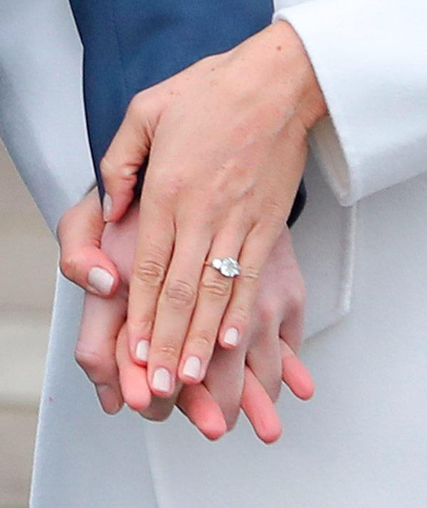 Meghan's engagement ring is set on a gold band, and features a diamond from Botswana — a place close to each of their hearts following several trips there as a couple — and two side stones which were taken from Harry's mother, Diana's, personal collection.