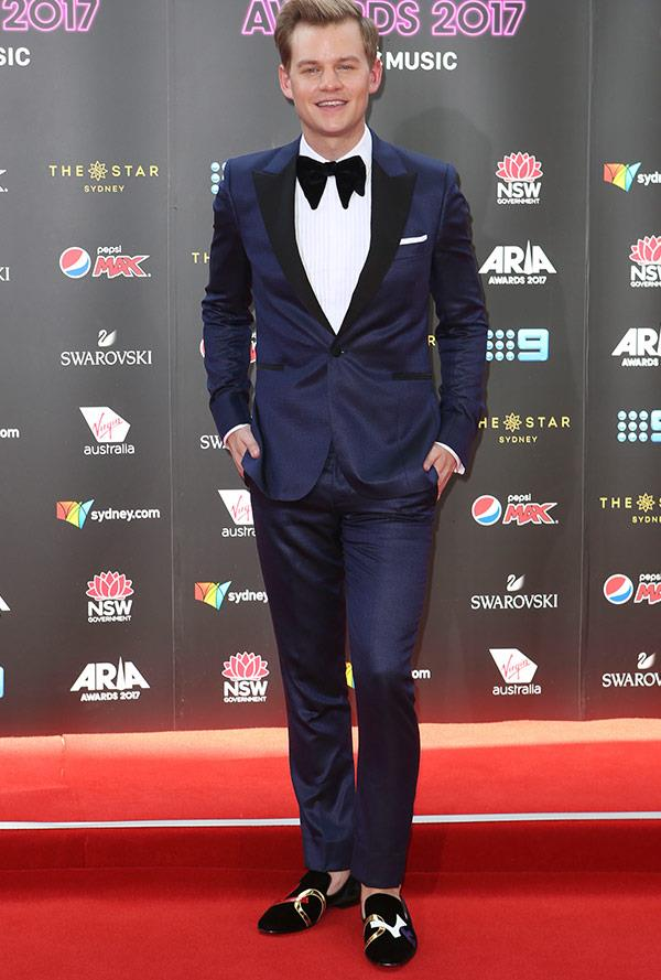 There's nothing funny about comedian Joel Creasey's dapper suit.