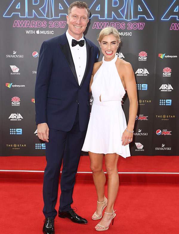 """How in love does Wiggles star [Simon Pryce](https://www.nowtolove.com.au/celebrity/celeb-news/red-wiggle-simon-pryce-and-lauren-hannaford-wedding-album-33477