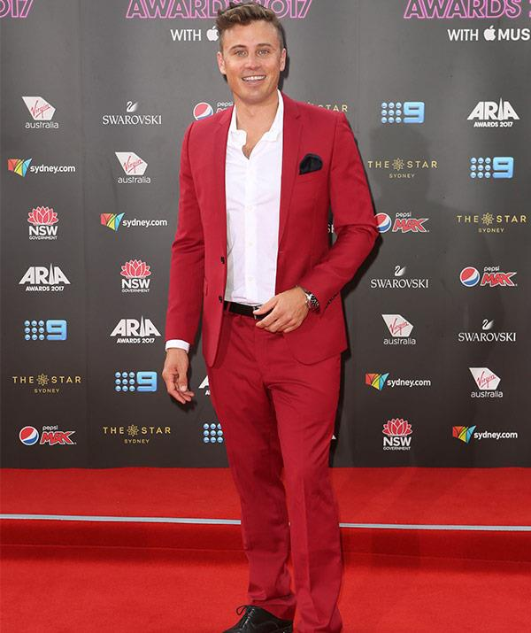 Presenter James Tobin matches his suit to the red carpet.