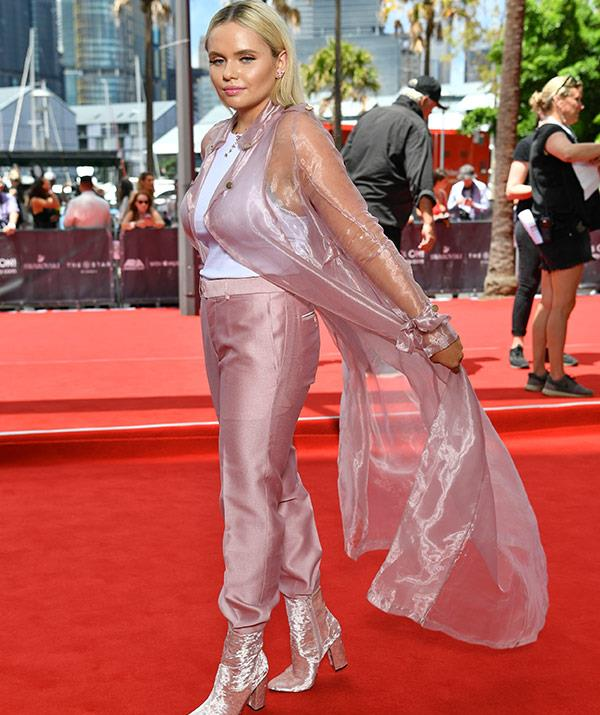 Singer Alli Simpson is pastel perfection in this pink suit and cape combo.