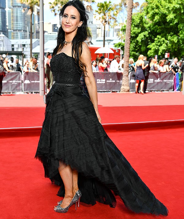 Former *Channel V* star Jane Gazzo makes a dramatic entrance in this strapless black gown.