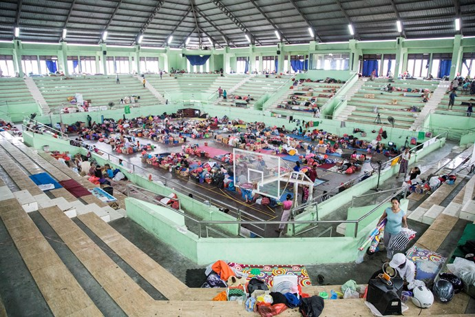 Evacuees in makeshift shelters.